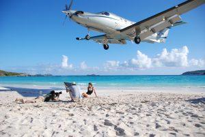 Tradewind Aviation flight landing on Saint Barth with model shoot
